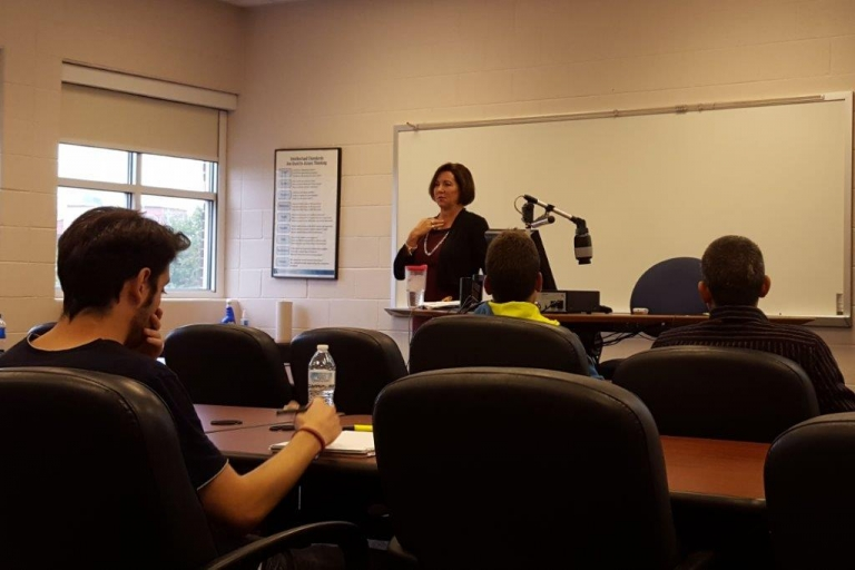 Jennifer Burke, partner at Crowe Horwath LLP, speaking with Dr. Isaacs' class