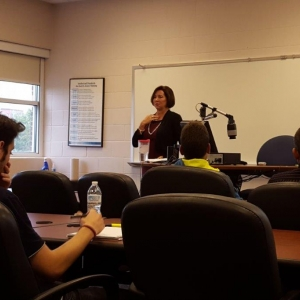 Jennifer Burke speaking with Dr. Isaacs' class